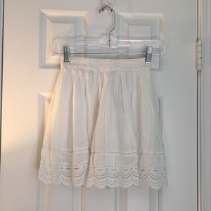 Laced trimmed, flowy white skirt